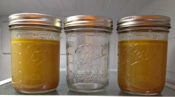 Jars of chicken broth from ground chicken backs